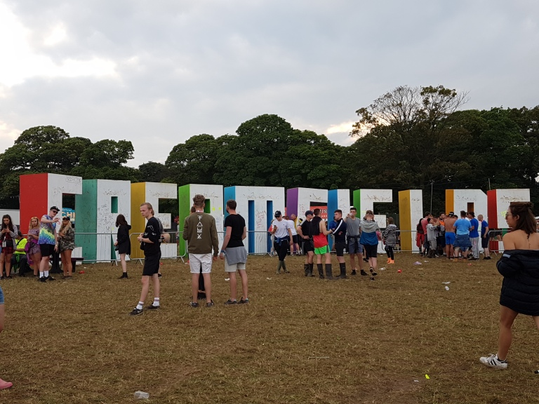 Creamfields 2016 attendees milling around the Creamfields sign (photo by Danceclubgirl)